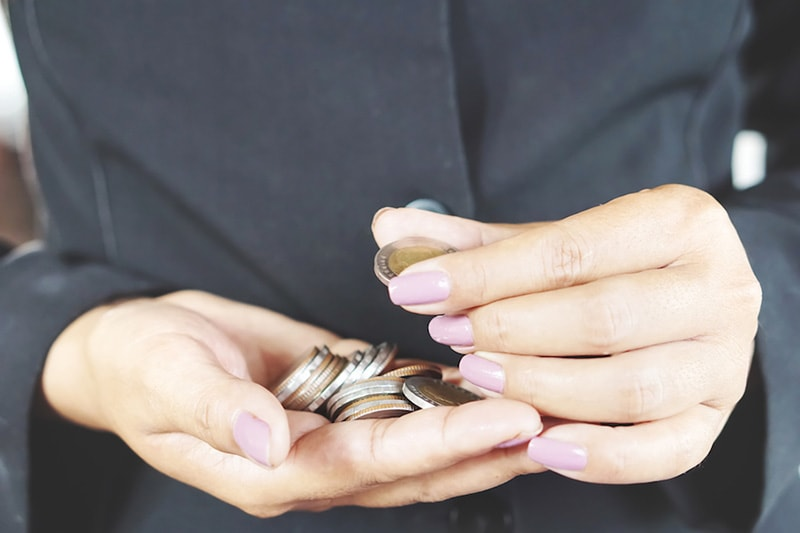 financing, how can i afford a new ac system, woman counting coins